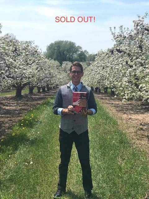 Wade Rouse/Viola Shipman standing in an orchard holding a copy of THE RECIPE BOX